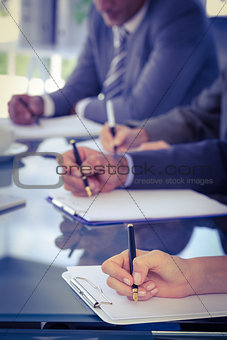 Business team taking notes at meeting