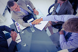 Business team shaking hands at meeting