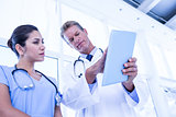 Nurse and doctor looking at tablet pc