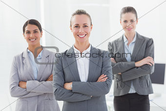 Business team standing arms crossed