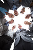 Smiling business team standing in circle
