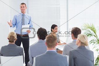 Smiling businessman talking during conference