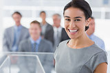 Smiling businesswoman looking at camera during conference