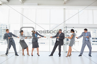 Business team pulling the rope