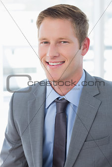 Smiling businessman looking at camera
