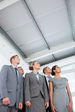 Business team looking up