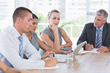 Concentrated business team during meeting