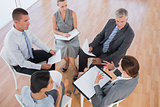 Business team sitting in circle and discussing
