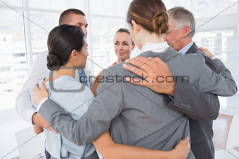 Business team standing in circle