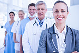 Smiling team of doctors standing in line