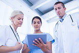 Doctors looking together at tablet