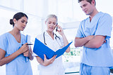Team of doctors looking at folder