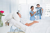 Doctors examining patients xray