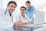 Team of doctors smiling at camera