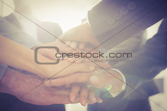 Business team standing hands together