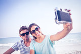happy couple taking selfie