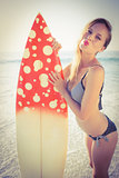 Beautiful surfer on the beach