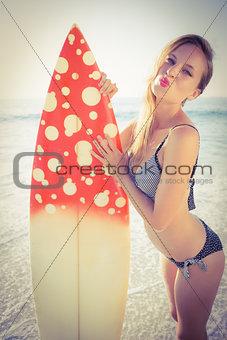 Beautiful surfer on the beach