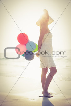 Beautiful blonde holding balloons