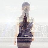 Composite image of walking businesswoman