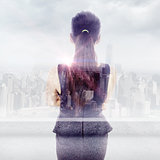 Composite image of standing businesswoman
