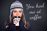 Composite image of beautiful woman in warm clothing drinking coffee