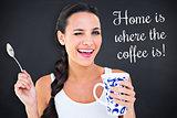 Composite image of pretty brunette having cup of tea