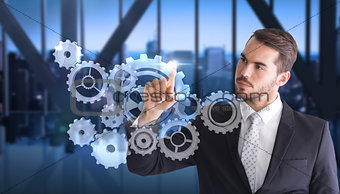 Composite image of thoughtful businessman pointing something with his finger