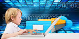 Composite image of cute boy using laptop