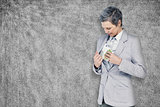 Composite image of businesswoman taking bribe