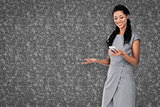Composite image of businesswoman using smartphone