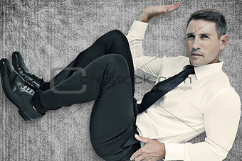 Composite image of trapped businessman