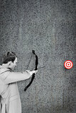 Composite image of businessman shooting target