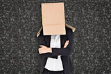 Composite image of businesswoman lifting box off head