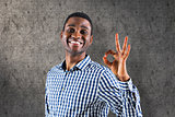 Composite image of happy businessman making ok sign