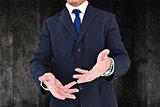 Composite image of smiling businessman in suit with arm out