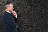 Composite image of elegant businessman in suit posing
