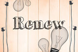 Renew against light bulb on wooden background