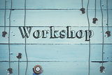 Workshop against plugs on wooden background