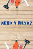 Need a hand? against tools on wooden background