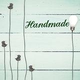 Handmade against light bulbs on wooden background