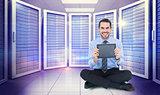 Composite image of smiling businessman showing his digital tablet