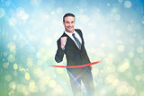Composite image of happy businessman crossing the finish line