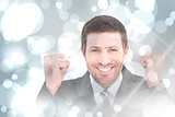 Composite image of businessman smiling and cheering
