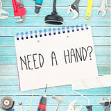 Need a hand? against tools and notepad on wooden background
