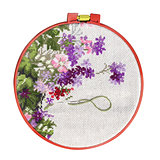 Handmade cross-stitch with floral pattern on canvas