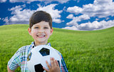 Cute Boy with Soccer Ball in Park