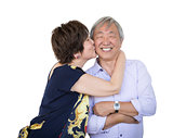 Affectionate Senior Chinese Couple Isolated on White