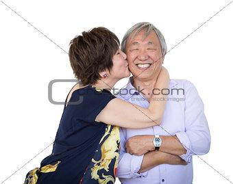 Affectionate Senior Chinese Couple Isolated on White