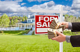 Man Handing Over Money in Front House For Sale, Sign